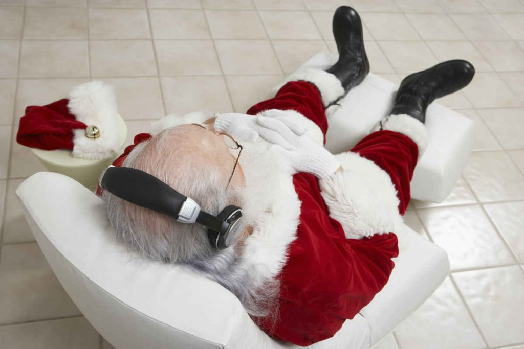 santa sitting on a relaxing chair
