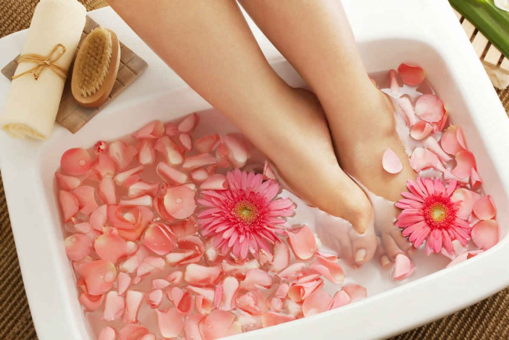 feet in a foot spa with water