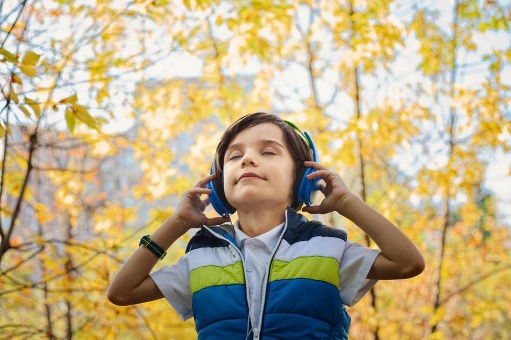 boy listening to headphones
